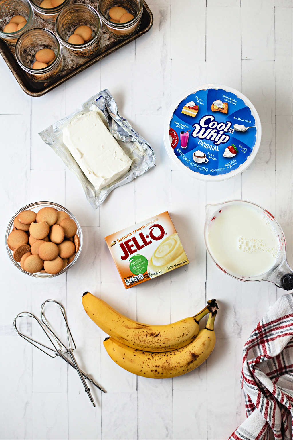 ingredients for no bake banana pudding on a table.
