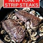 two New York strip steaks with mushrooms in a cast iron skillet.