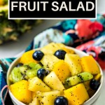 TROPICAL FRUIT SALAD IN A BOWL ON A TABLE.