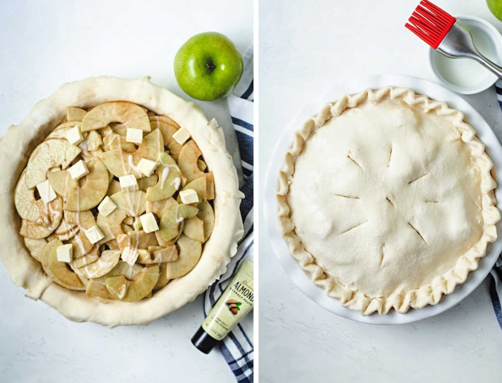 pie dough overlapping a pie dish filled with sliced apples with butter pieces on top; unbaked apple pie with the top crust dusted with sugar.