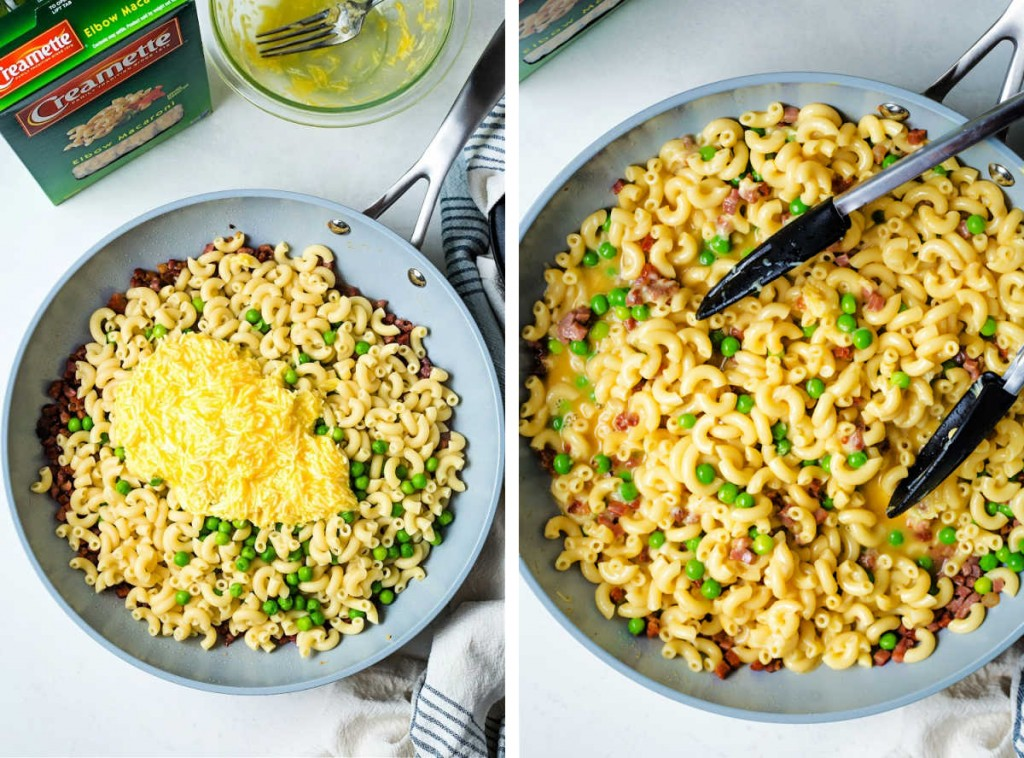a frying pan with elbow macaroni and emulsified egg yolks and cheese being tossed together with tongs.